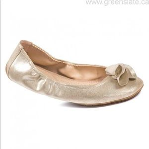Gold Me Too Ballet Flats with flower detail.